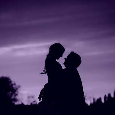Loving couple in silhouette holding each other